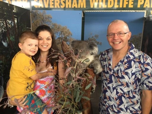 Graham Taylor with son Harvey, holding a koala bear